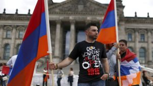 Supporters hold Armenian flags in front of the Reichstag, the seat of the lower house of parliament Bundestag in Berlin, Germany, on June 2, 2016.PHOTO: REUTERS